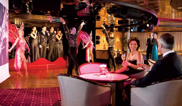 Watch colourful shows in the Astor Lounge